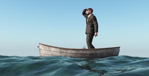 bigstock-lost-man-in-a-boat-12118265.jpg