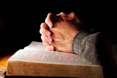 bigstock-praying-hands-man-bible-2780594