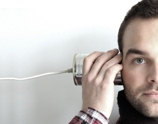 man-listening-ear-can-string.jpeg
