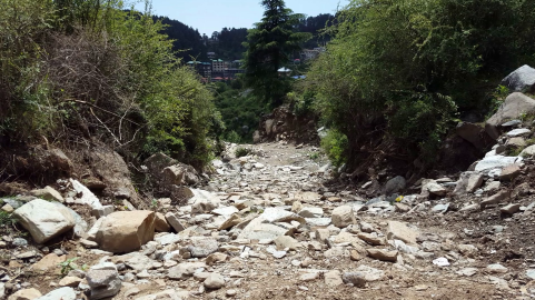 dry-river-road-path-bhagsu-himalaya-mountains-india_rkxf8w74nx_thumbnail-full01